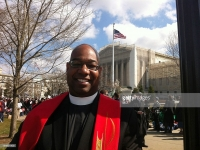 "MCCDC_DeWayne Davis, a clergy candidate at Metropolitan Community Church of Washington, D.C., said he was ""proud"" to be standing among supporters of gay marriage outside the Supreme Court as arguments on California's Proposition 8 are heard in Washington on Tuesday, March 26, 2013. (Curtis Tate/MCT)"